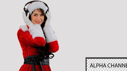 Thumbnail for Weihnachten Mädchen In Kopfhörer 1