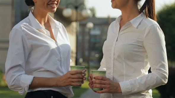 Thumbnail for Two Girls Having Conversation During Coffee