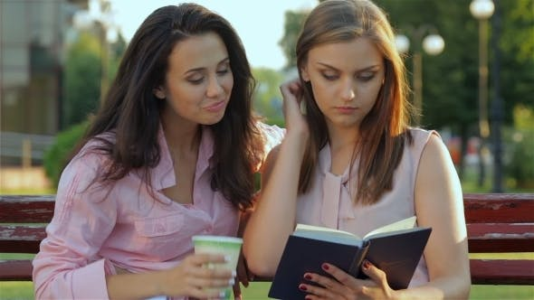 Cover Image for Two Girls Having Conversation About The Book
