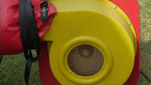 A Red Blower Used to Inflate the Zorb Ball