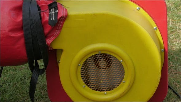 Thumbnail for A Red Blower Used to Inflate the Zorb Ball