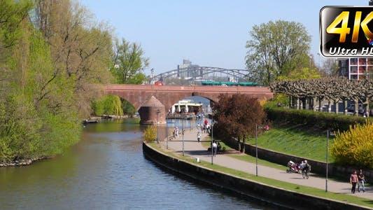 Main River and Bridge and People in Frankfurt