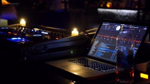 Dj Mixing Tracks In Nightclub At Party