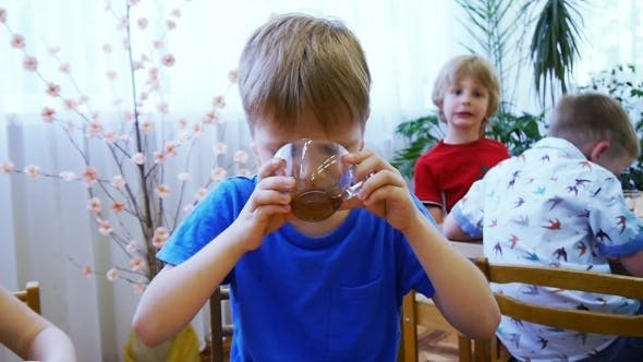 Cover Image for Boy Drinks Tea From a Mug