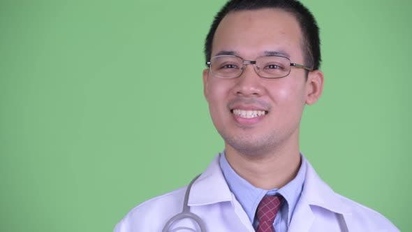 Thumbnail for Face of Happy Asian Man Doctor with Eyeglasses Thinking