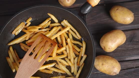 French Fries Fried in the Pan. Rotates Slowly.