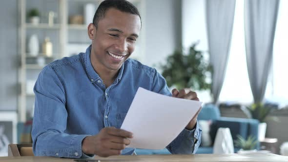 Thumbnail for Young African Man Excited after Reading Documents