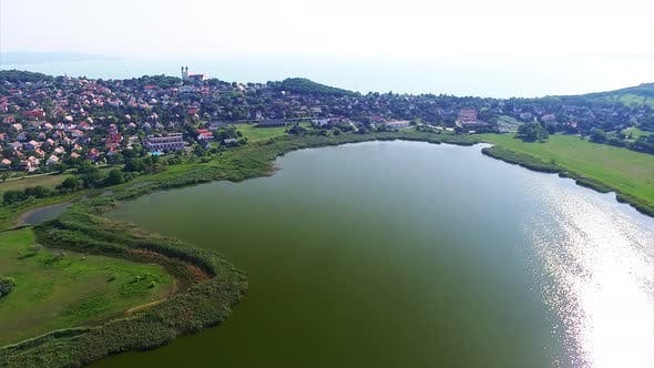 Thumbnail for Aerial view over Belso lake and neighborhood houses in Tihany in summer. Hungary