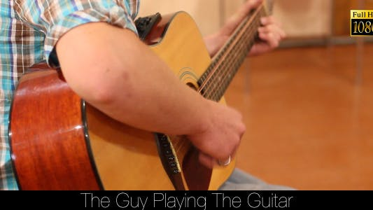 Cover Image for The Guy Playing The Guitar