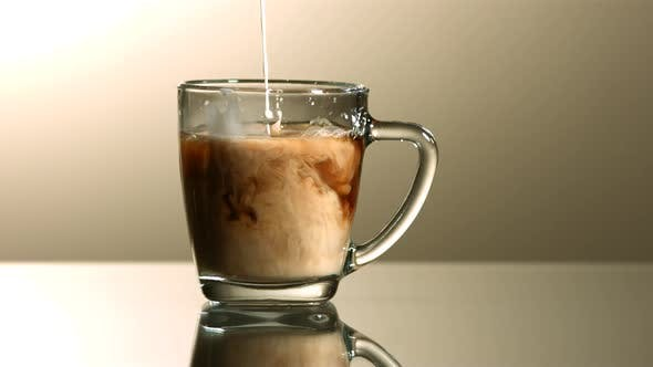 Thumbnail for Milk poured into coffee in ultra slow motion 1500fps - COFFEE w MILK PHANTOM