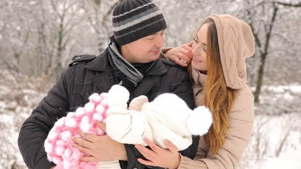 Thumbnail for Young Happy Family With Baby In Winter