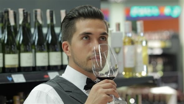 Thumbnail for Sommelier With Red Wine And Smelling It