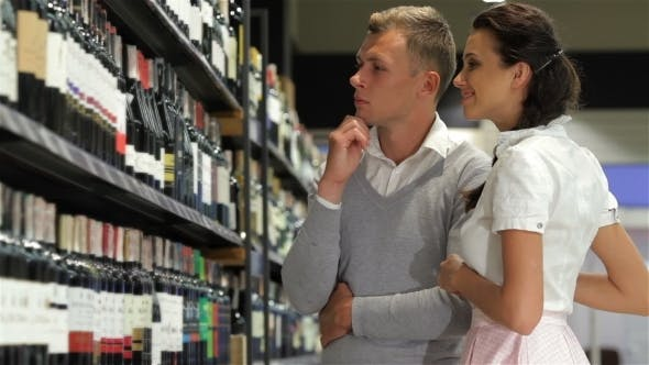 American Shoppers Choosing At Liquor Store