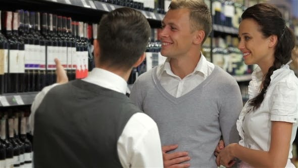 Thumbnail for Sommelier Giving Shoppers Recommendation