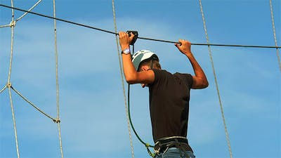 Man Holding the Rope and  Goes the Rope Way
