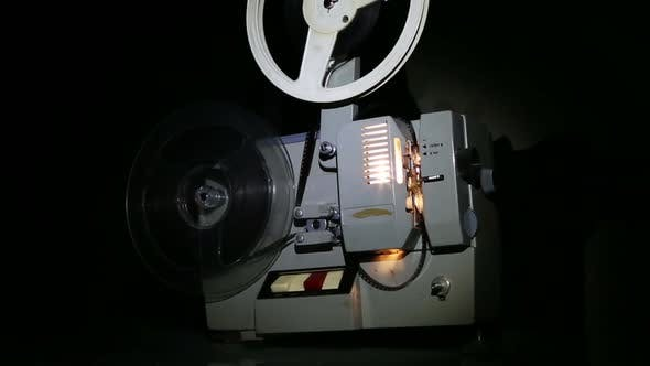 Thumbnail for Old Projector Showing Film - Dolly Shot 1