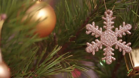 Thumbnail for Decorative Snowflake On Christmas Tree Decorated  Flashing Garlands - Dolly Shot