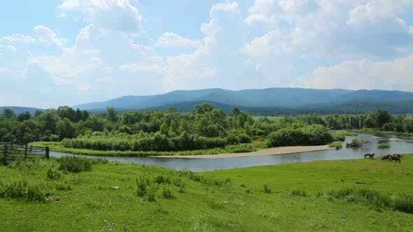 Thumbnail for Summer Panorama Landscape  River Between Mountains And Grazing Horses