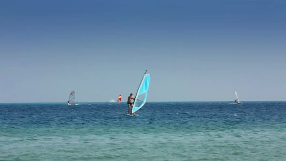 Thumbnail for Windsurfing - Man Learns To Ride On Windsurfer 1