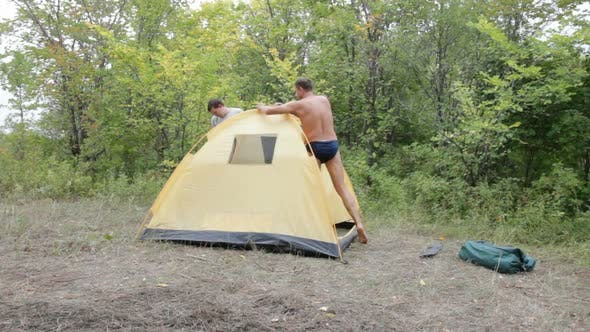 Two Men Removed A Tent