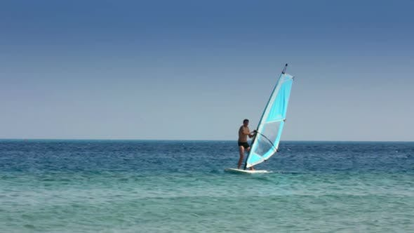 Thumbnail for Windsurfing - Man Learns To Ride On Windsurfer 2