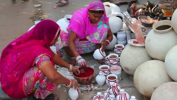 Thumbnail for Women Paint Pots In The City Market - Jodhpur India