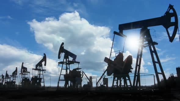Thumbnail for Working Oil Pumps Silhouette Against  Clouds 1