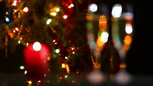 Thumbnail for Glasses  Champagne And Candle Against Christmas Lights - Rack Focus