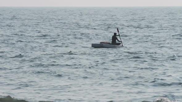 Thumbnail for Lone Fisherman Floating In Sea On Fishing - Kerala India