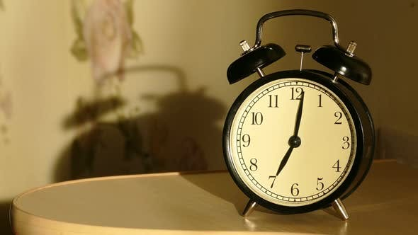Thumbnail for Vintage Alarm Clock On Nightstand Counts The Time And Then Loudly Ringing