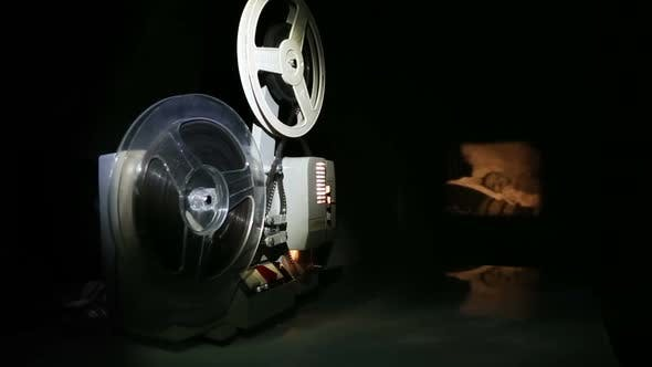 Thumbnail for Old Projector Showing Film On Screen - Dolly Shot 2