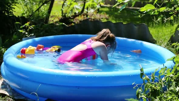 Thumbnail for Cheerful Girl In Inflatable Pool In Summer Garden - 2
