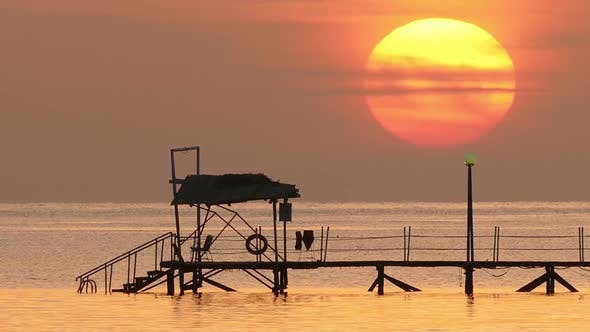 Thumbnail for Beautiful Sunrise Over Pier In Sea - Filmed At Telephoto Lens 1