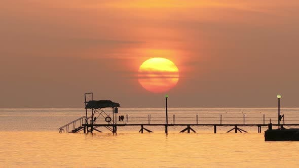 Thumbnail for Beautiful Sunrise Over Pier In Sea - Filmed At Telephoto Lens 3