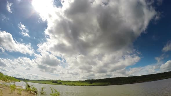 Thumbnail for Clouds Moving Over River - Wide-Angle Shot