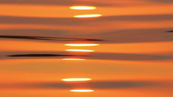 Thumbnail for Reflection Of Sunrise On Water Surface