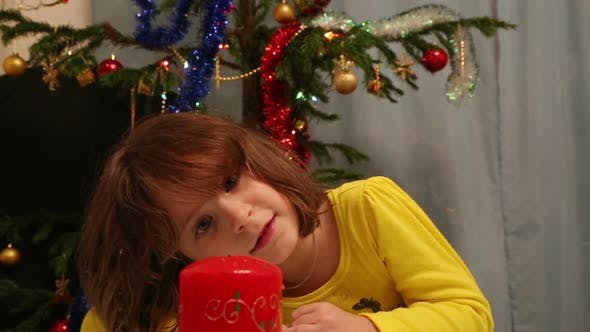 Thumbnail for Christmas, Celebration, Holiday, Xmas - Cute Child Blowing On Candle And Makes A Wish