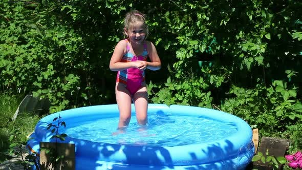 Thumbnail for Cheerful Girl In Inflatable Pool In Summer Garden 1