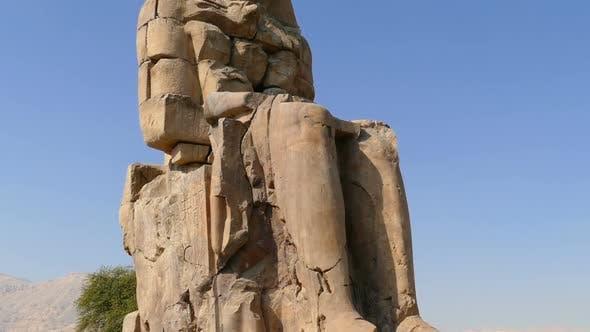 Thumbnail for Colossi Of Memnon Gigantic Statues In Luxor Egypt - Tilt View