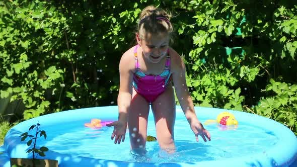 Thumbnail for Cheerful Girl In Inflatable Pool In Summer Garden 2