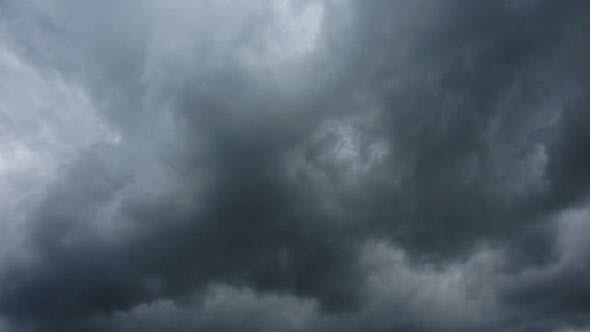 Dark Storm Clouds Are Moving Fast At Viewer -