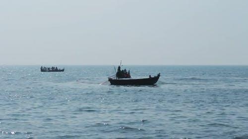 Fishermen In Boats Pulling Fishing Nets - Kerala India 1