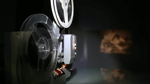 Thumbnail for Old Projector Showing Film On Screen - Dolly Shot 1