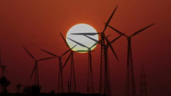 Thumbnail for Wind Farm - Turning Windmills On Background Of Setting Sun