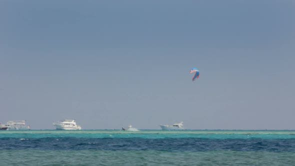 Thumbnail for Kite Surfing - Surfers On Blue Sea Surface 1