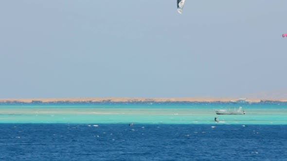 Thumbnail for Kite Surfing - Surfers On Blue Sea Surface 6