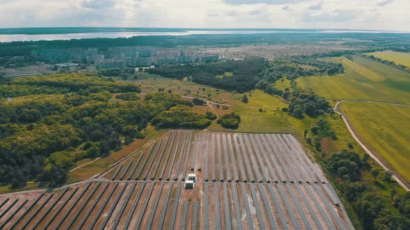 Cover Image for Aerial View on Solar Power Station in Green Field Near Small City at Sunny Day