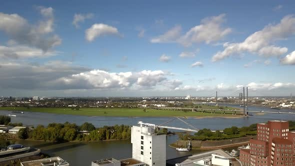 Thumbnail for AERIAL: Cityscape Wide View Over Dusseldorf, Germany with TV Tower on Beautiful Sunny Day with Blue