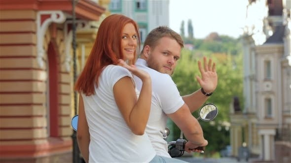 Thumbnail for Rear View Couple Riding On Moped