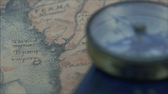 Thumbnail for Compass and a Map on the Table